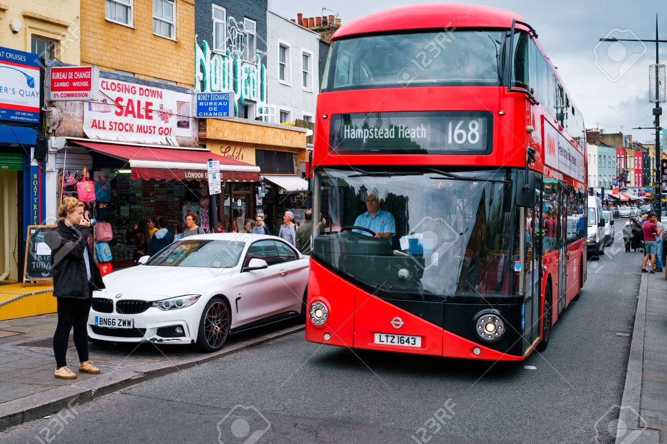 Red double decker bus at the Camden Town street market in London - 150064971