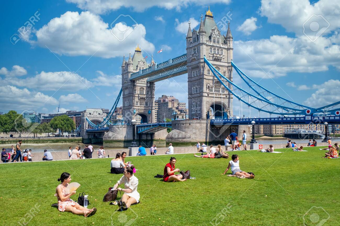People enjoying summer near Tower Bridge in London - 150041661