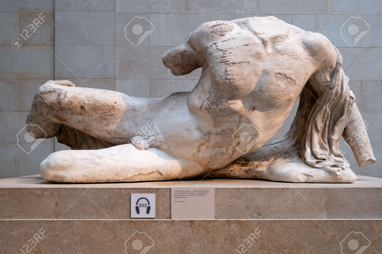 Ancient greek statue from the Parthenon exhibited at the British Museum in London - 152053430