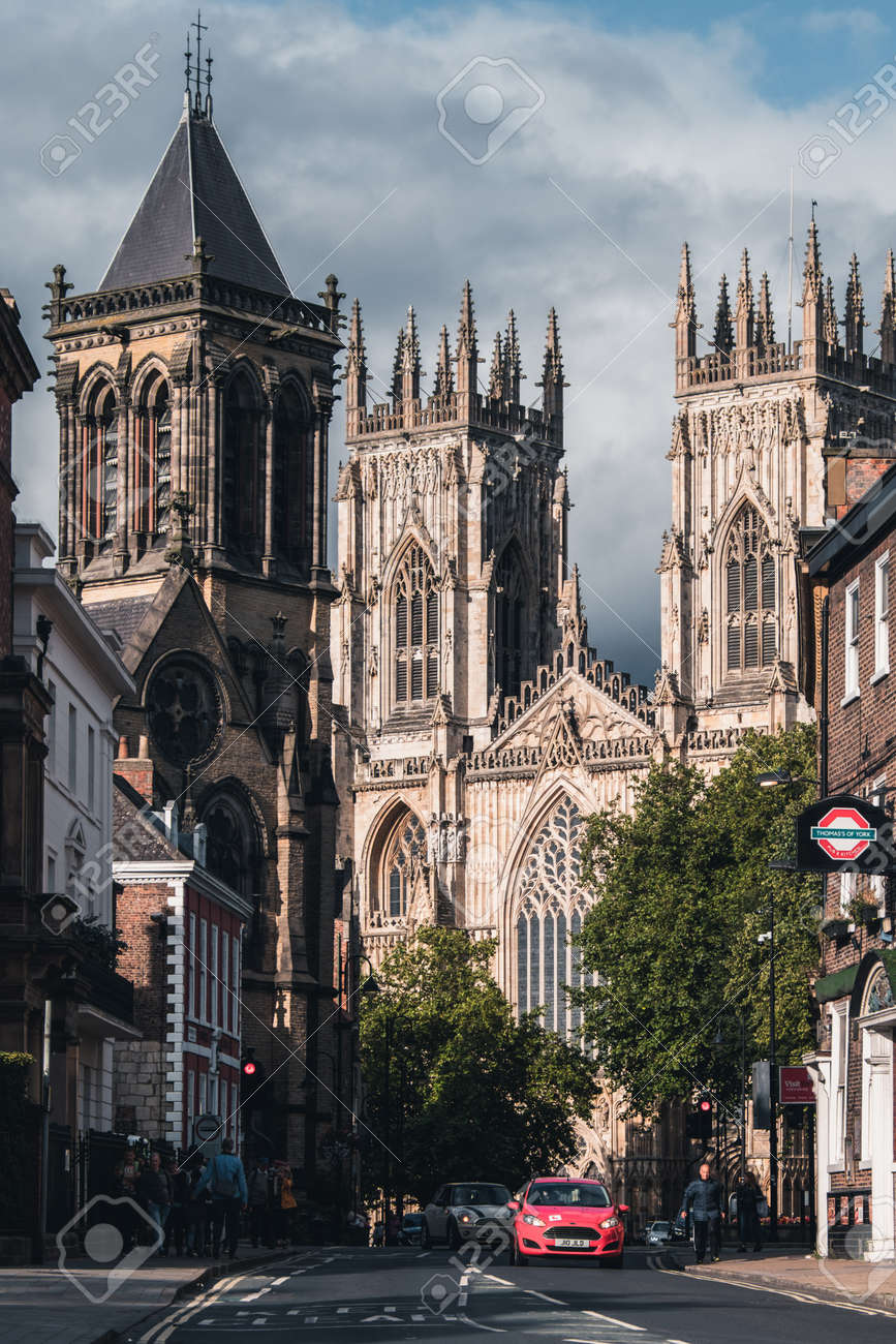 Street scene in York with a view of the York Cathedral and several historic buildings - 158962815