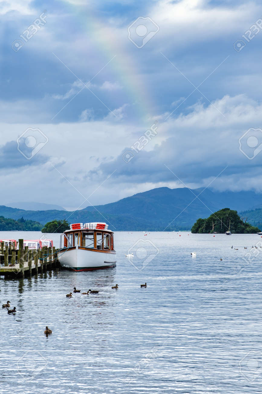 Rainbow over Lake Windermere on the beautiful Lake District in England - 158974043
