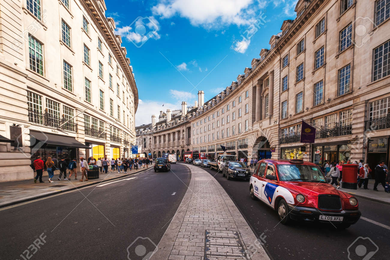 One of the iconic London taxis at Regent Street, a major shopping street famous for its architecture and its flagship stores - 158962809