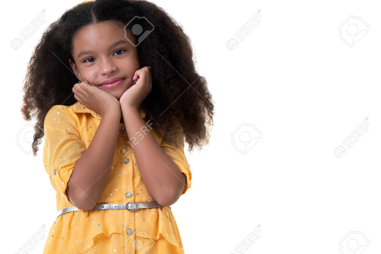 Portrait of a cute multiracial small girl with an innicent expression - Isolated on white - 159904545