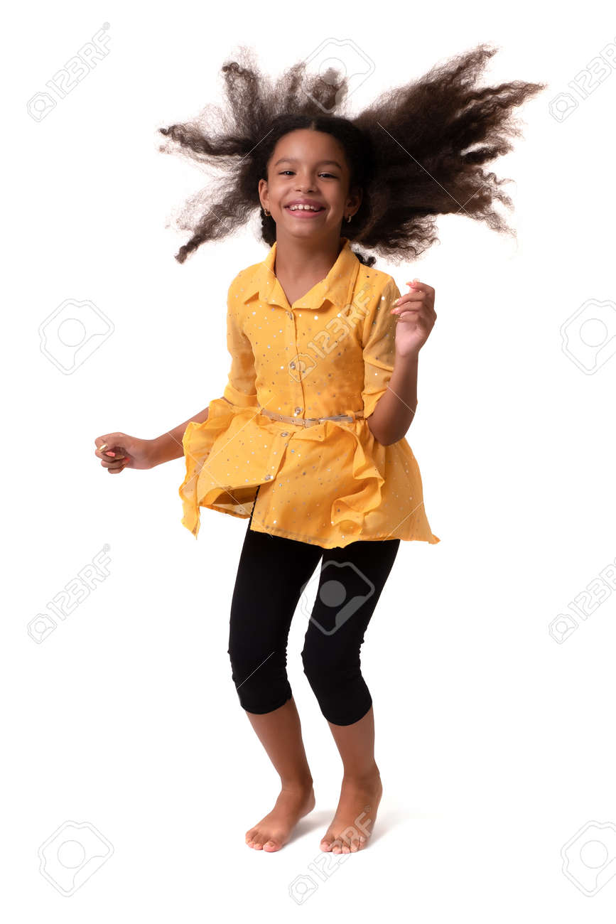 Happy multiracial small girl jumping and laughing - Isolated on white - 159904456