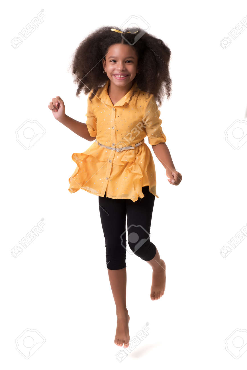 Happy multiracial small girl jumping or running and laughing - Isolated on white - 159904522
