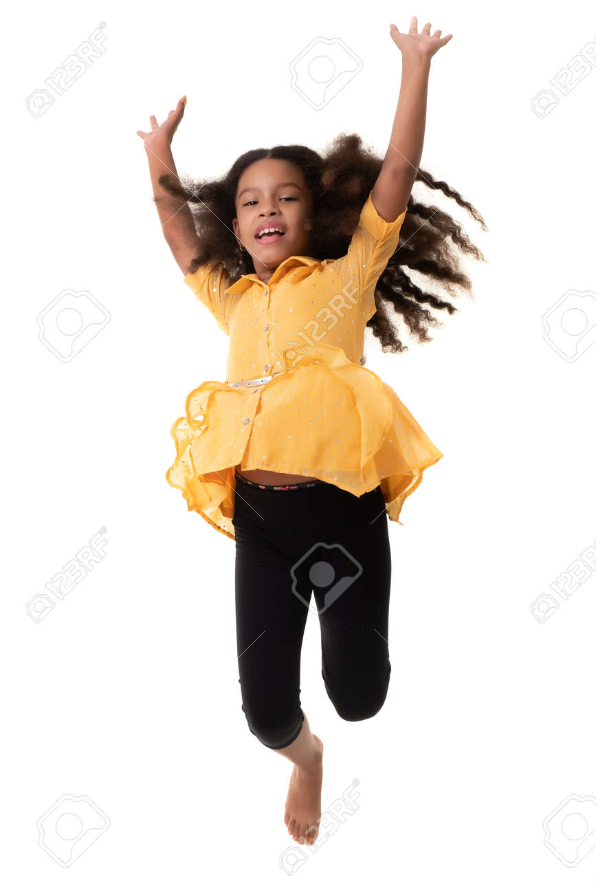 Happy multiracial small girl jumping in the air and laughing - Isolated on white - 159904908