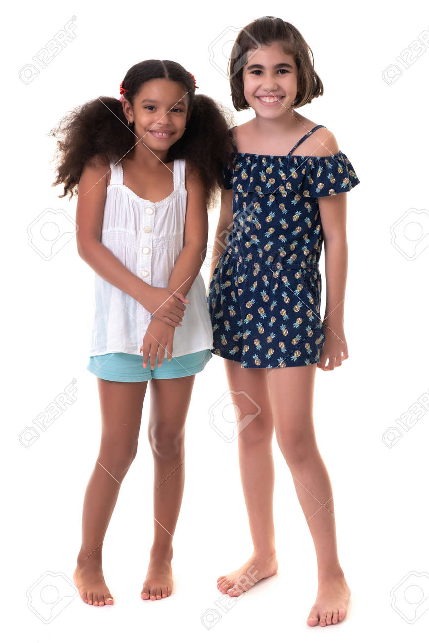 Two friendly small girls, friends or sisters - Hispanic and african-american - Isolated on white - 163555136