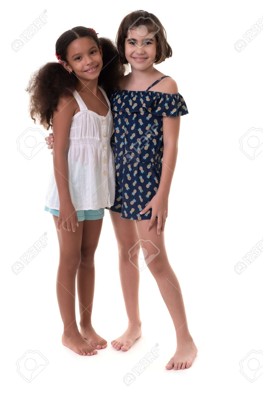 Two friendly small girls, friends or sisters - Hispanic and african-american - Isolated on white - 163555137