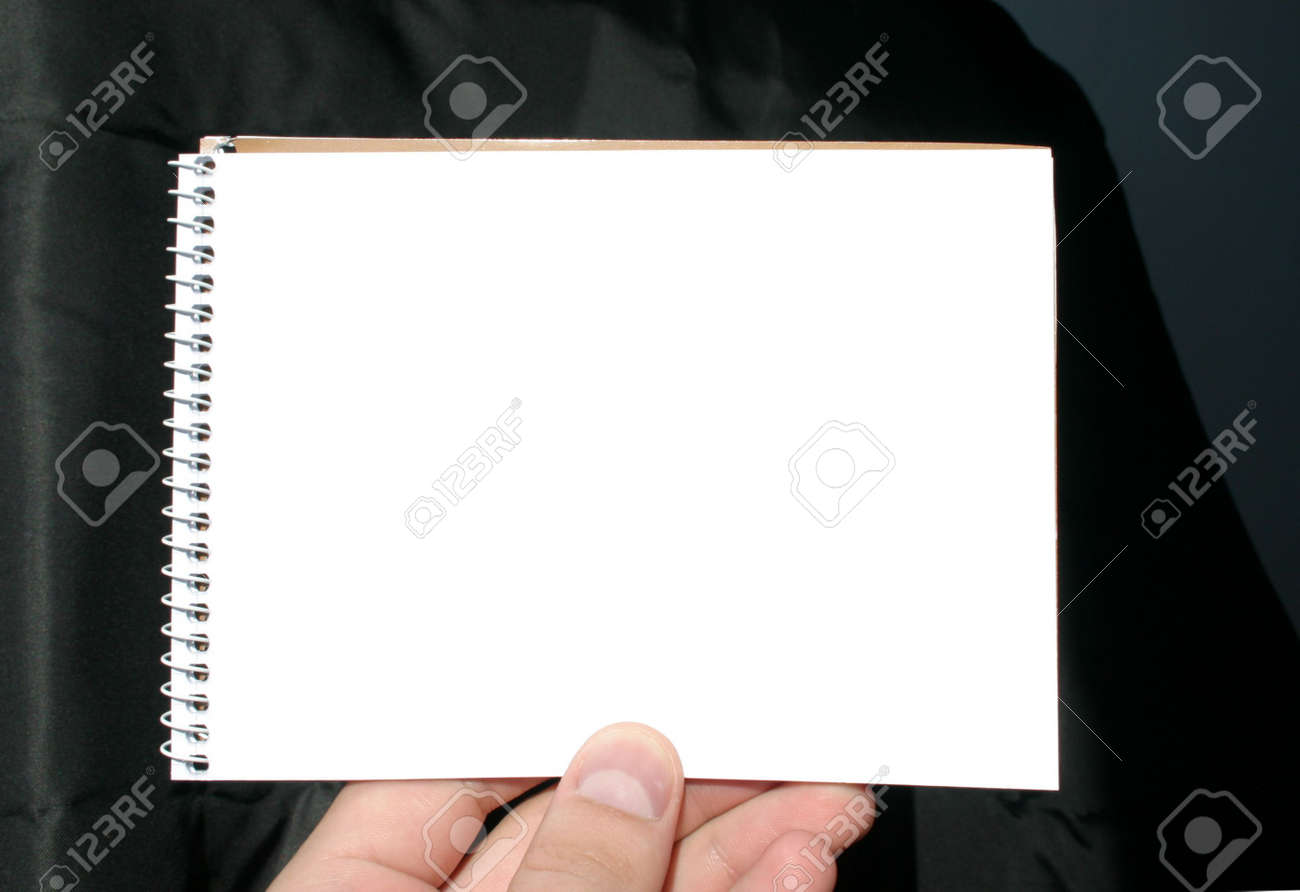holding blank spiral notebook on abstract background Stock Photo - 329397