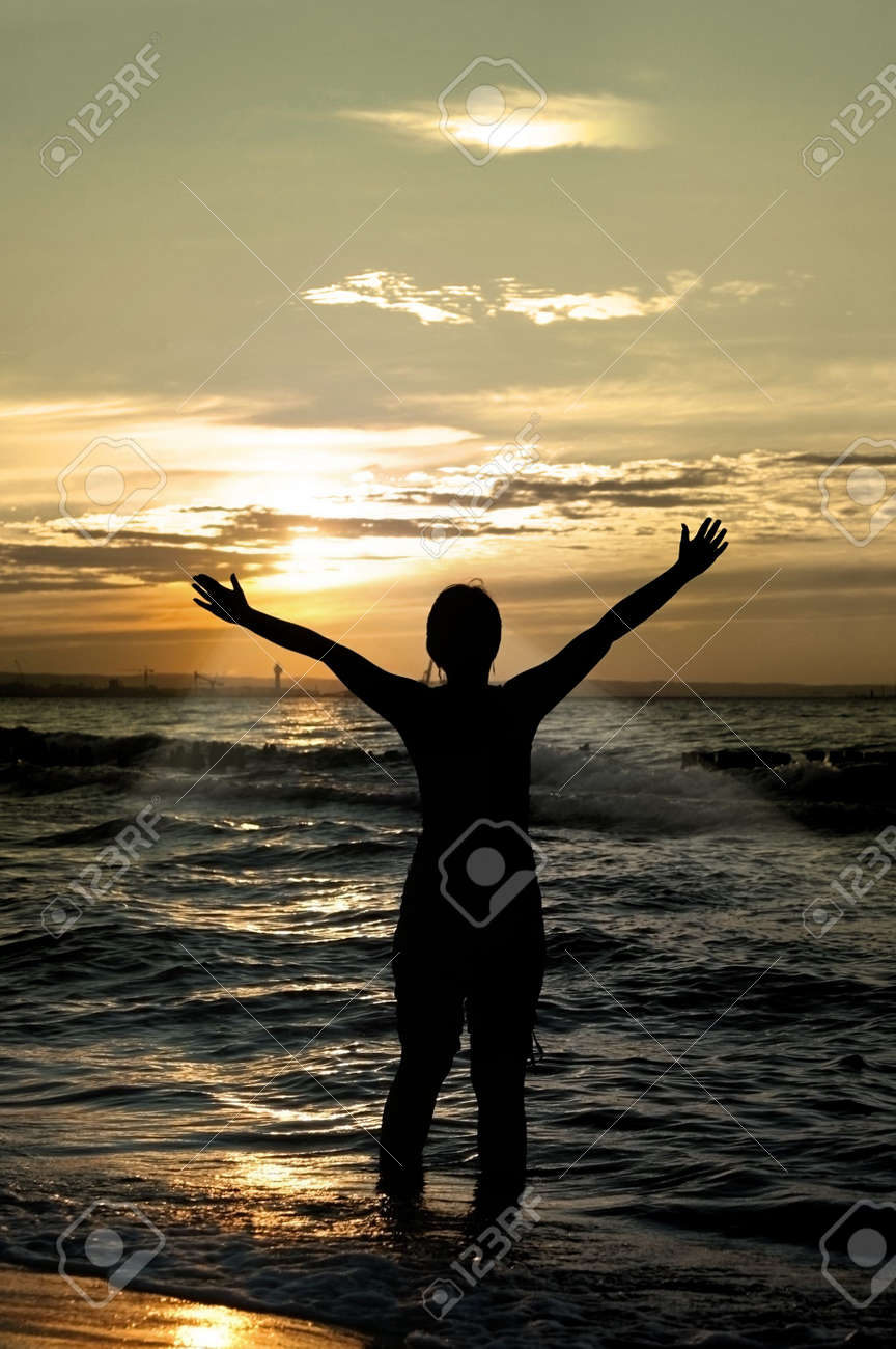 worshipper against incredible summer sunset on the beach, person isn't identifable Stock Photo - 1906657
