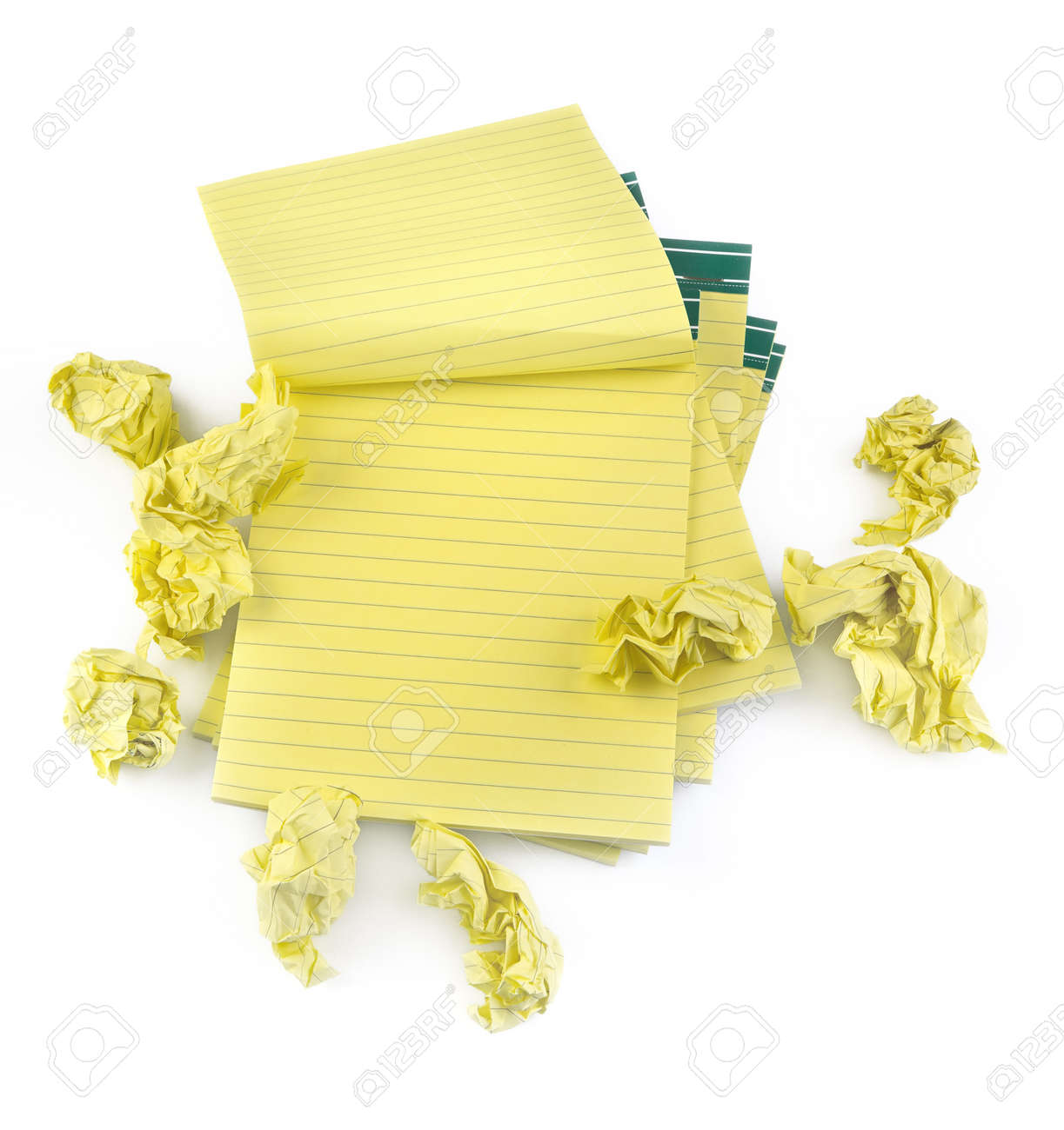 lined paper notebooks and crumpled paper on white background Stock Photo - 5848928