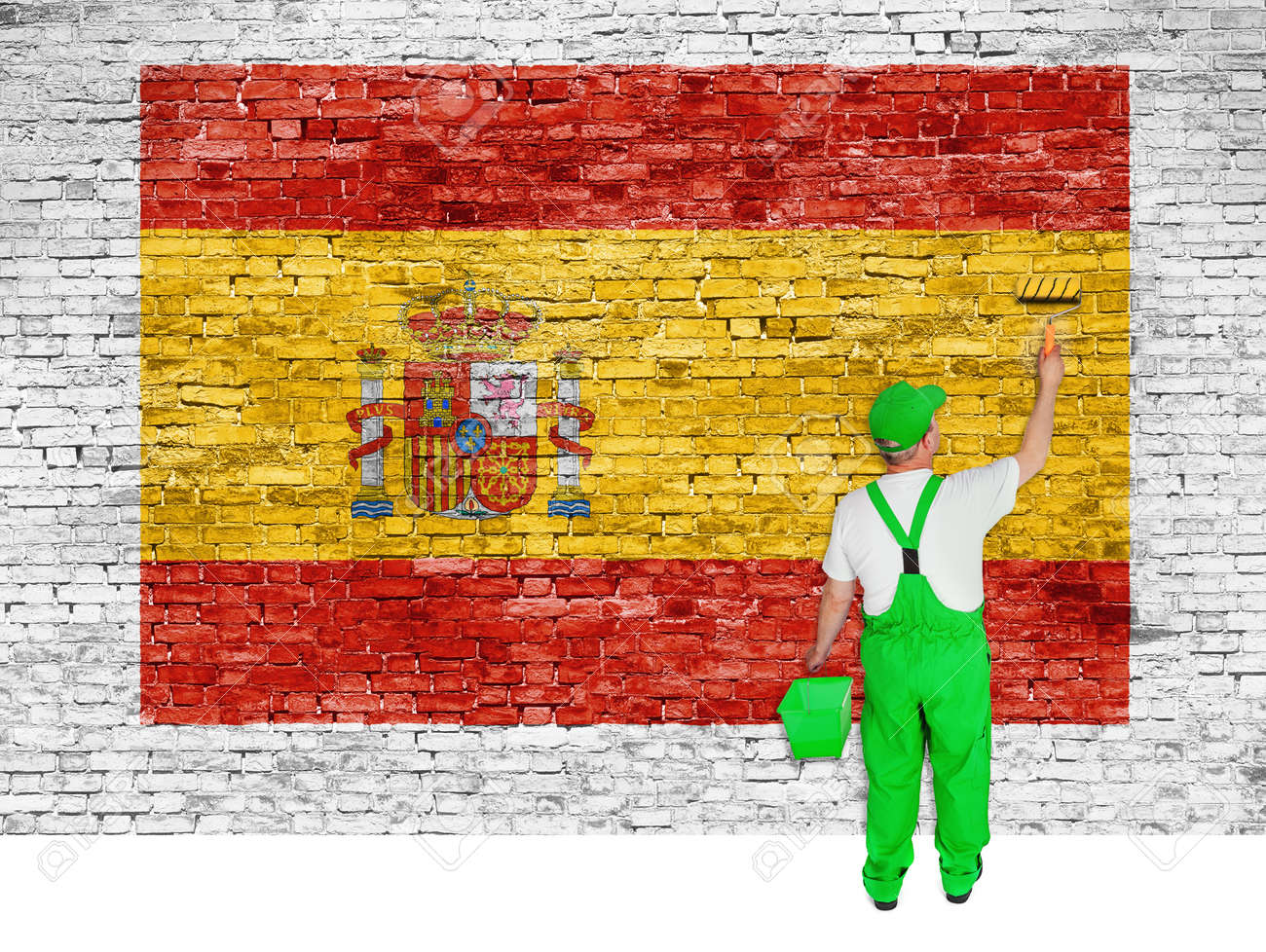 House Painter Paints Flag Of Spain On White Brick Wall Stock Photo ...
