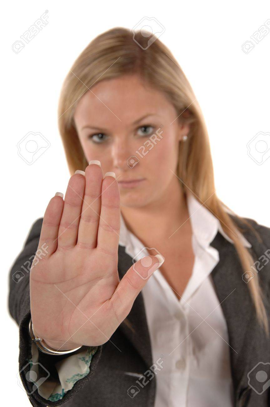 Blond women in business clothing with hand up signaling STOP Stock Photo - 1980173
