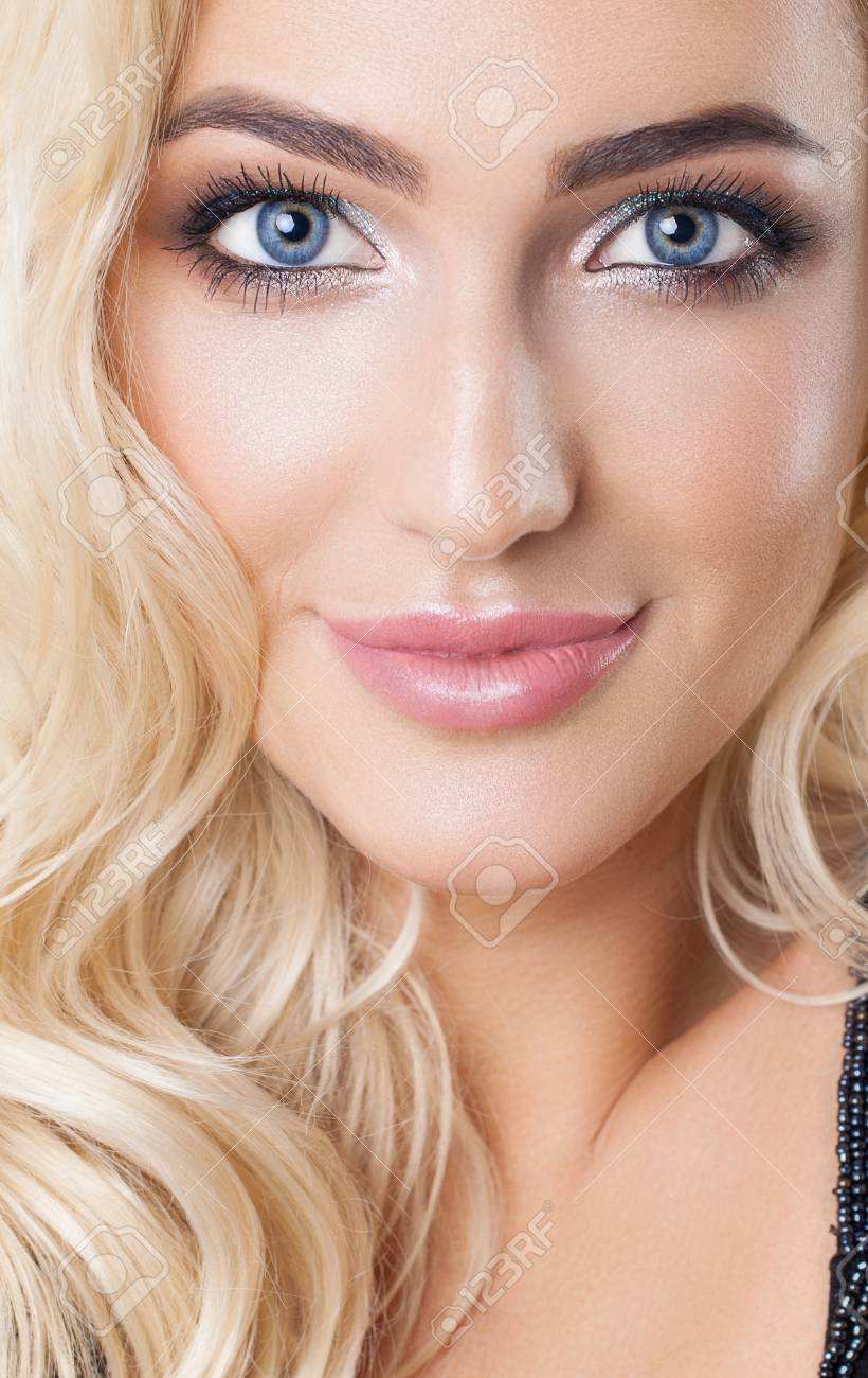 a087aa8955e Natural look. Studio. Portrait of beautiful blonde girl with healthy  perfect clean skin, big blue eyes, long