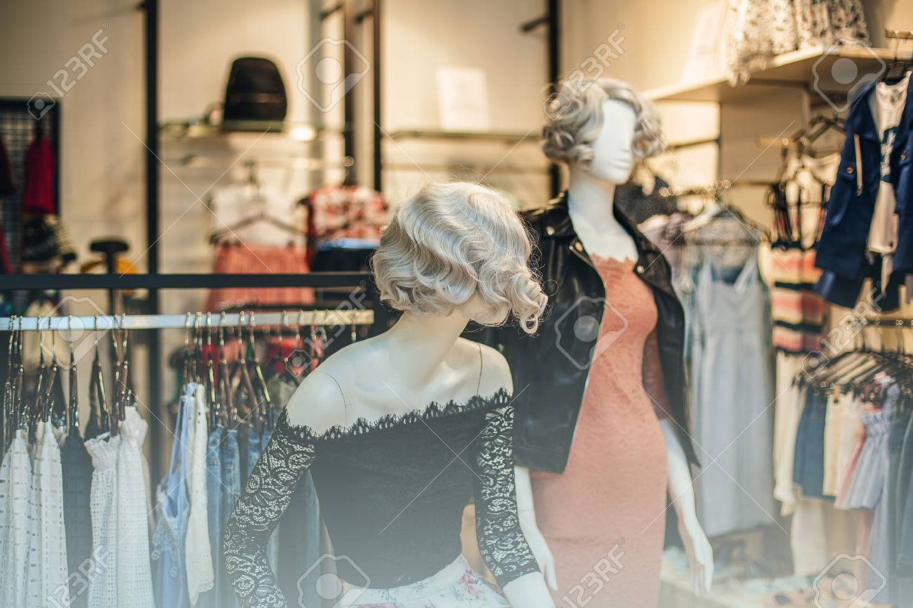 5eed29d7131b Colorful women s dresses on hangers in a retail shop. Fashion and shopping  concept. Indoor