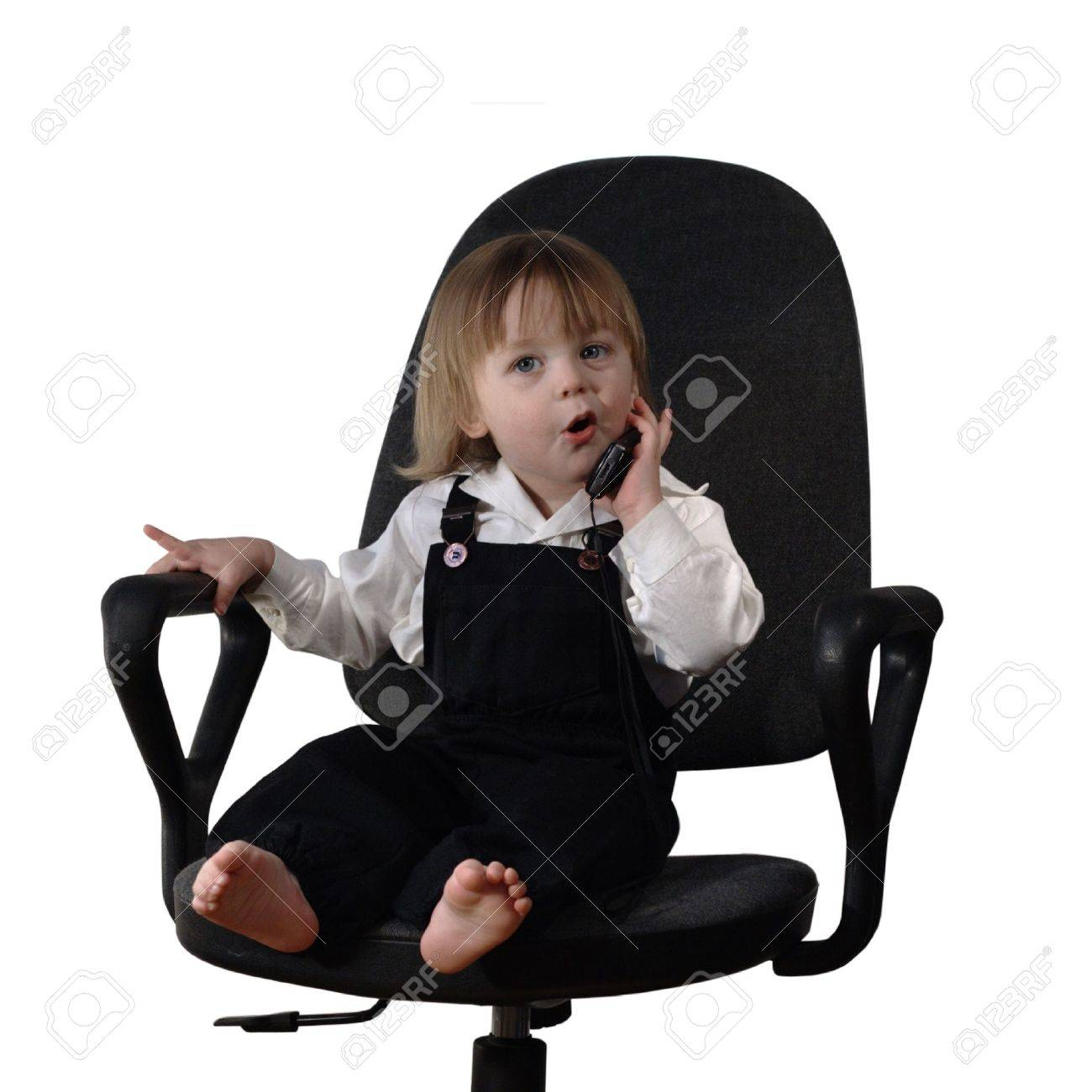 Child Years Old Sitting In The Office Chair And Talking Mobile