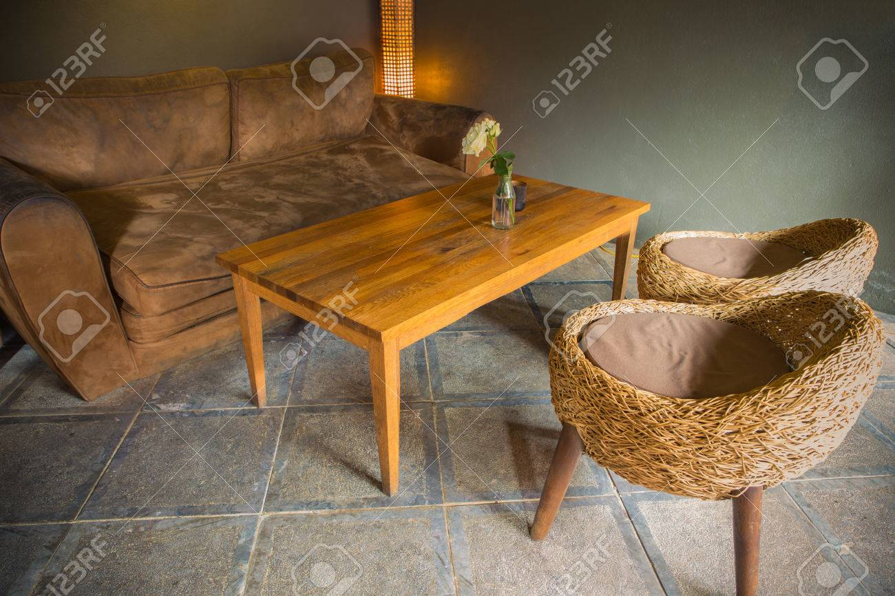 Light Brown Leather Sofa With Wicker Chair And Wood Table In Stock