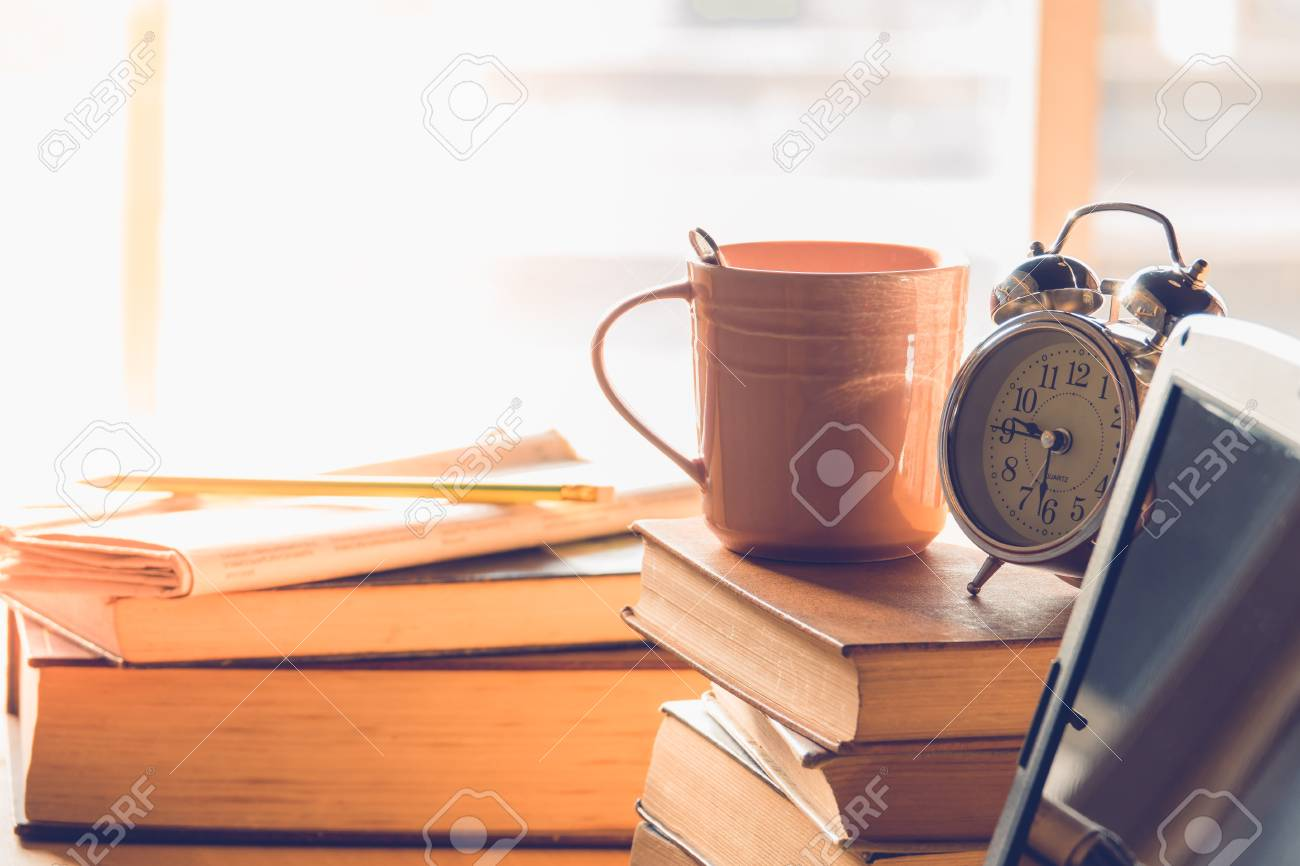 alarm clock on stack books on top of office table stock photo rh 123rf com Flip Top Table Flip Top Table