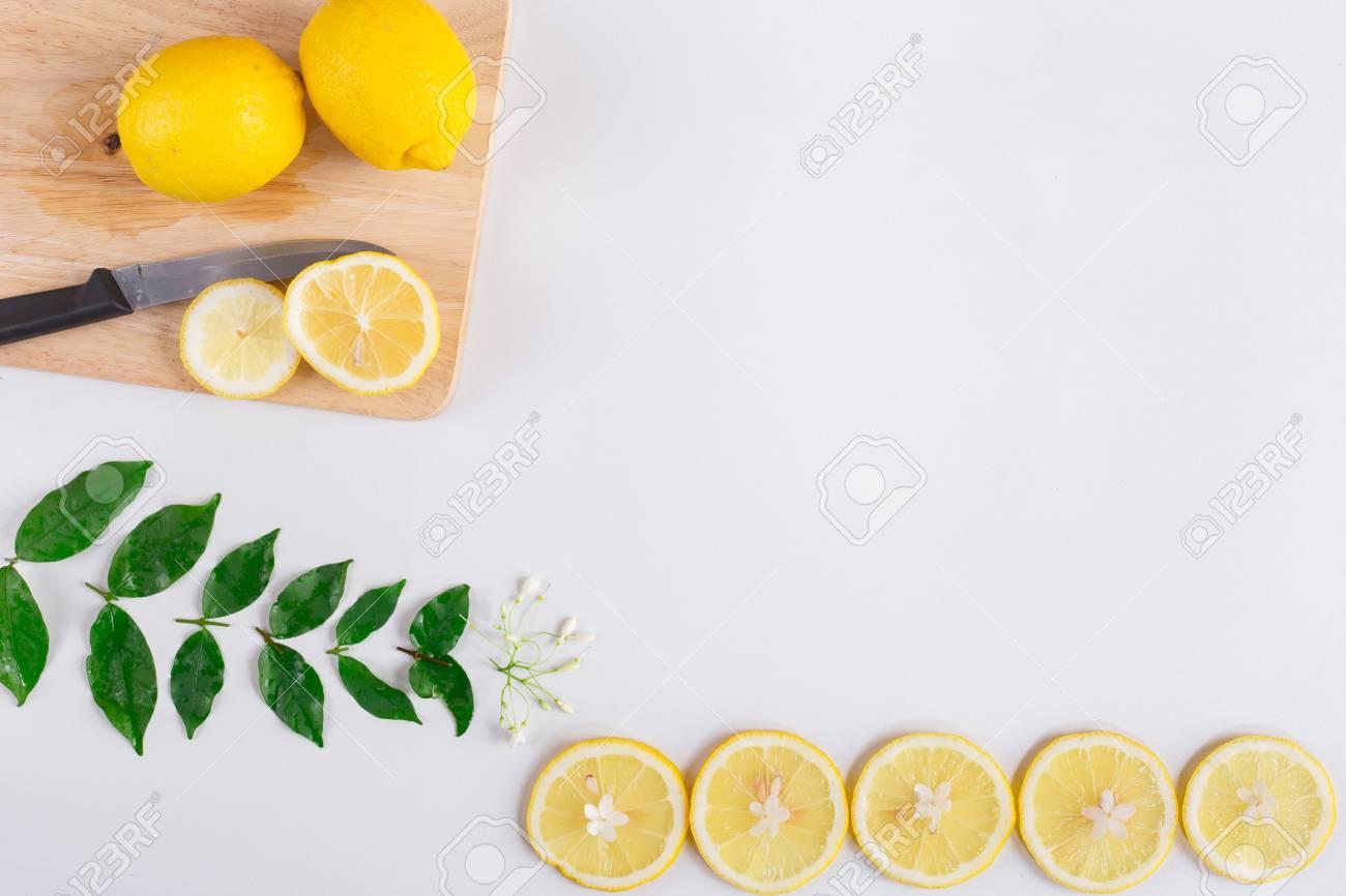 flat lay image of fresh lemon with lemon slice on white background