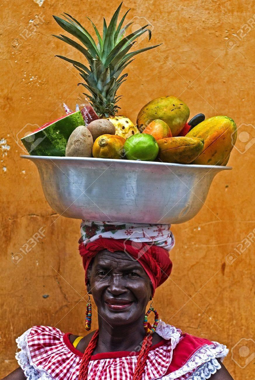CARTAGENA DE INDIAS , COLOMBIA - DEC 21:Unidentified Palenquera woman sell fruts in Cartagena de Indias on December 21 2010,Palenqueras are a unique African descendat ethnic group found in the north region of South America - 10678051