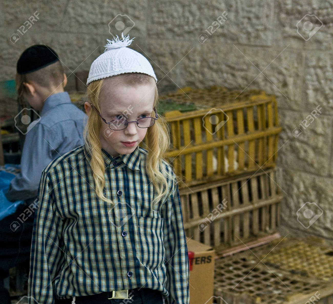 JERUSALEM - OCT 06  : An ultra Orthodox Jewish boy near a cages with chickens use for the Kapparot ceremony held in Jerusalem Israel on October 06 2011 Stock Photo - 10807662