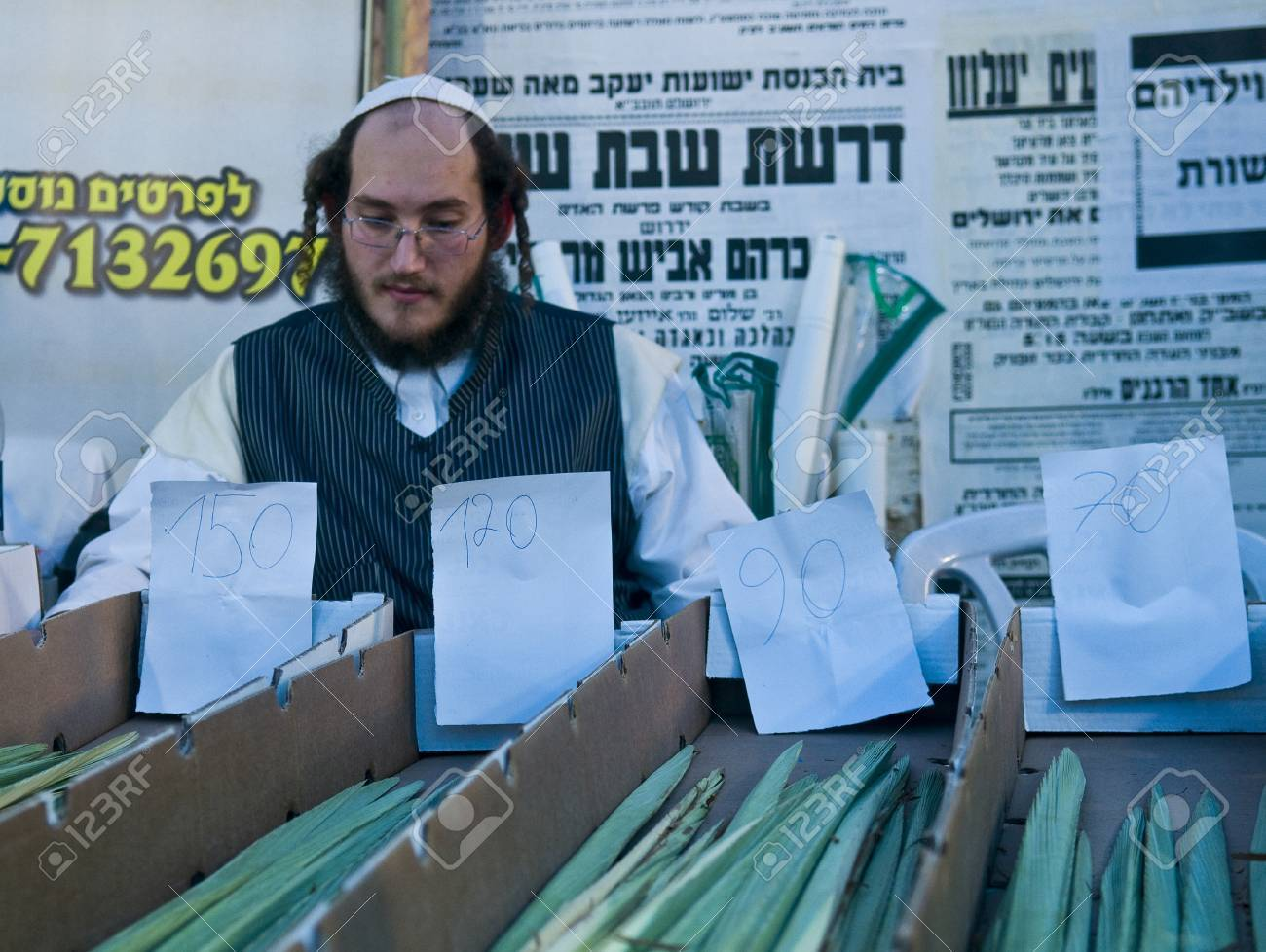 JERUSALEM - OCTOBER 10 2011 : An ultra-orthodox Jewish man sells Lulav in the market Stock Photo - 10839148