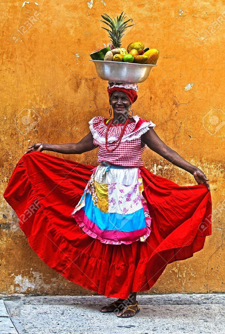 CARTAGENA DE INDIAS , COLOMBIA - DEC 21:Unidentified Palenquera woman sell fruts in Cartagena de Indias on December 21 2010,Palenqueras are a unique African descendat ethnic group found in the north region of South America - 10986561