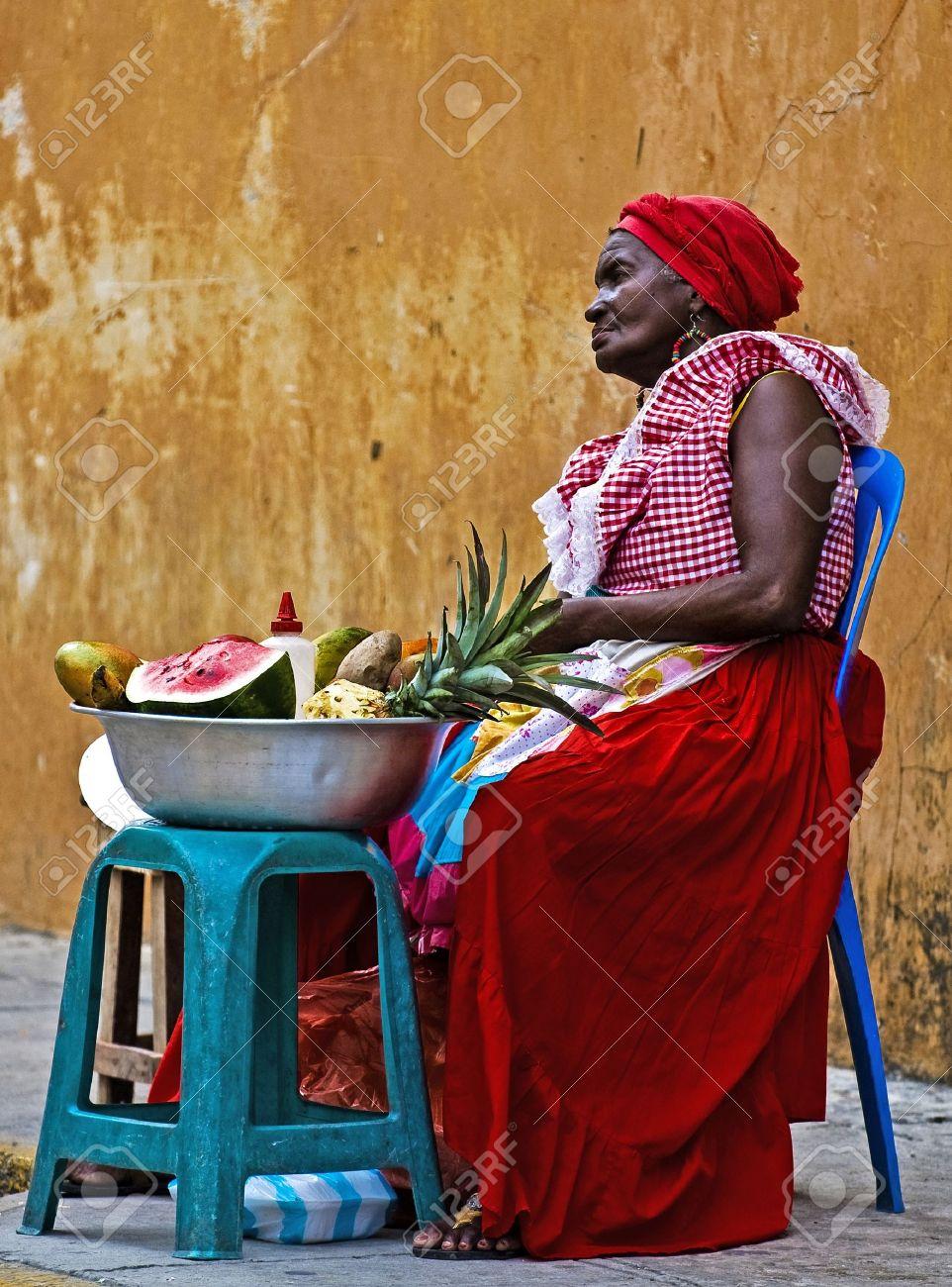 CARTAGENA DE INDIAS , COLOMBIA - DEC 21:Unidentified Palenquera woman sell fruts in Cartagena de Indias on December 21 2010,Palenqueras are a unique African descendat ethnic group found in the north region of South America - 11026008