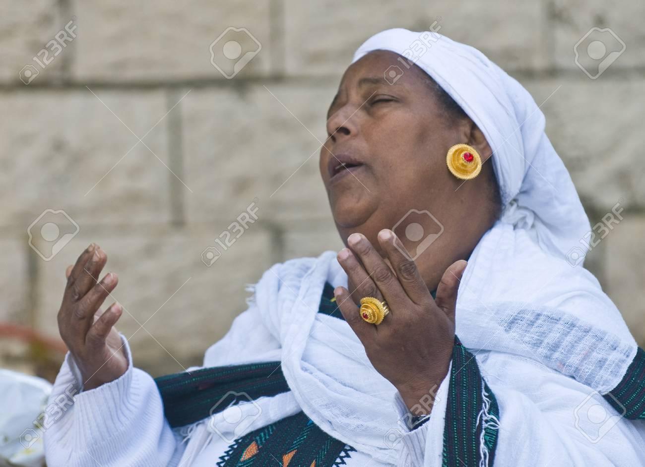 "JERUSALEM - NOV 24 : Ethiopian woman prays during the ""Sigd"" holiday in Jerusalem . Israel on November 24 2011 , The Jewish Ethiopean community celebrates the ""Sigd"" annualy in Jerusalem - 11305783"