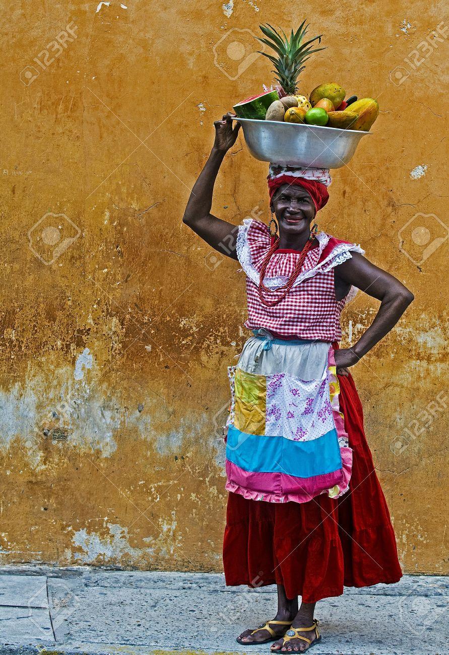 CARTAGENA DE INDIAS , COLOMBIA - DEC 21:Unidentified Palenquera woman sell fruts in Cartagena de Indias on December 21 2010,Palenqueras are a unique African descendat ethnic group found in the north region of South America - 11306153