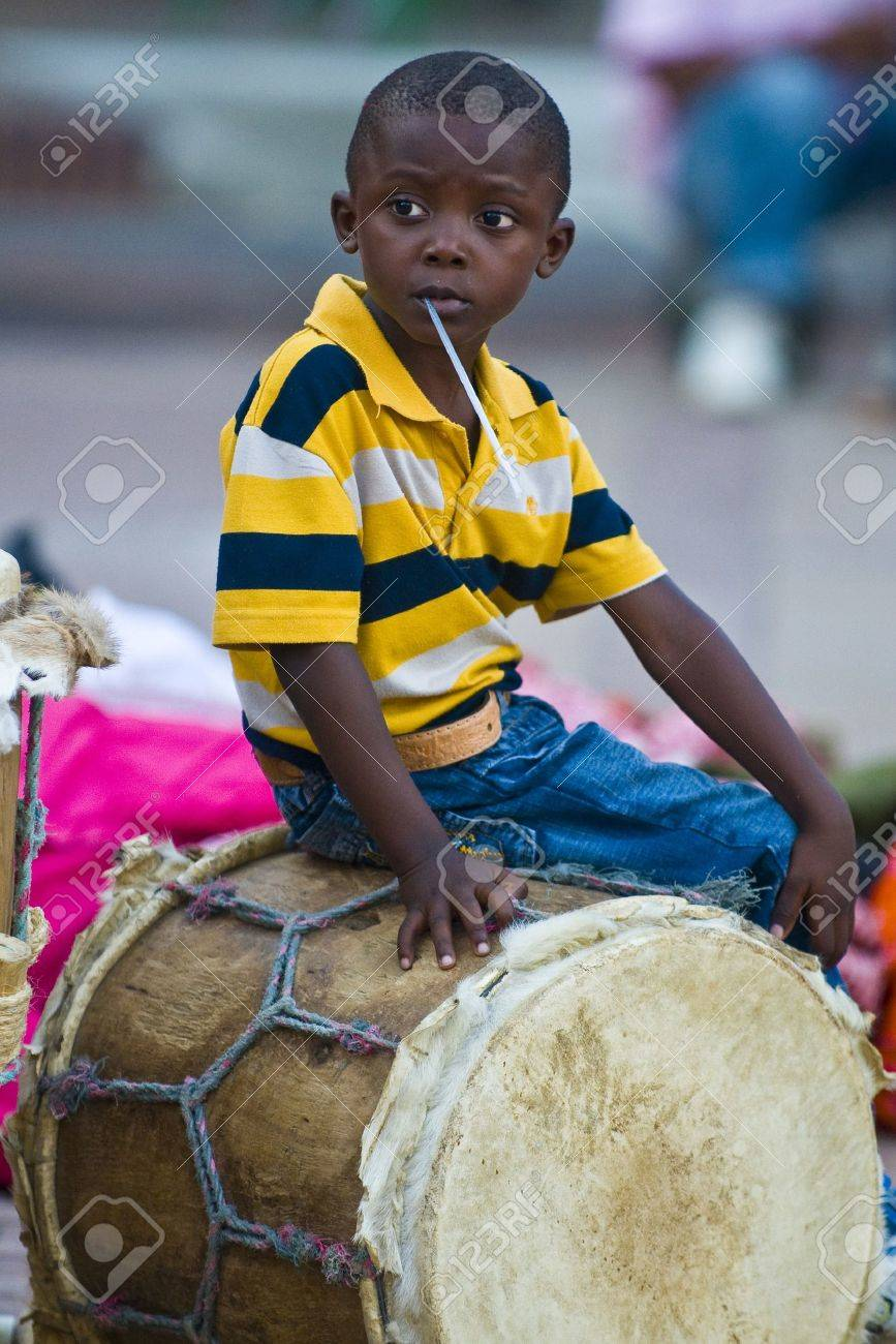 CARTAGENA , COLOMBIA - DEC 22 : Local child sitting on a drum while preparation for the celebration , held in the Unesco world heritage city of Cartagena , Colombia on December 22 2010 - 11314583