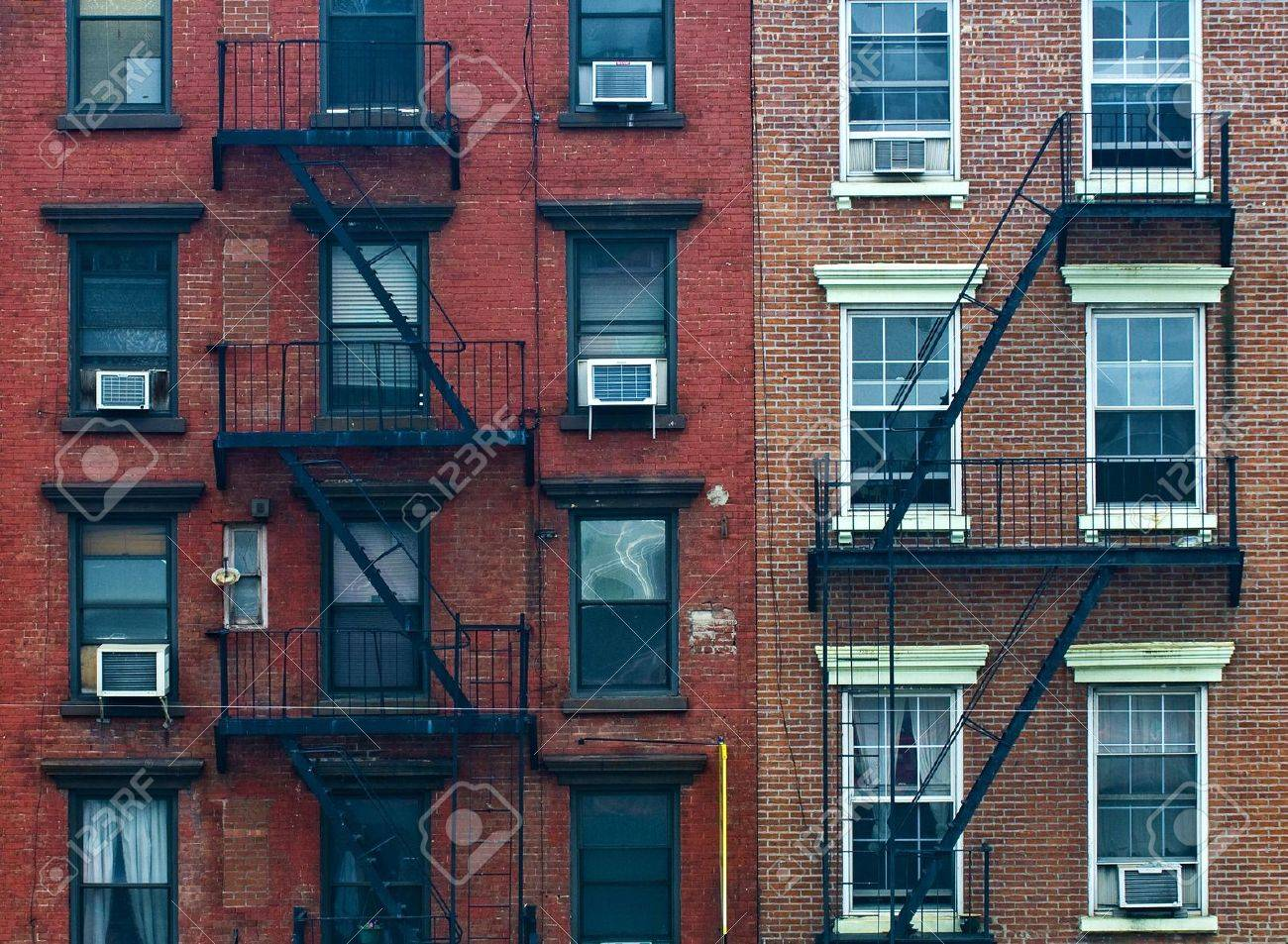 A fire escape of an apartment building in New York city - 11735239