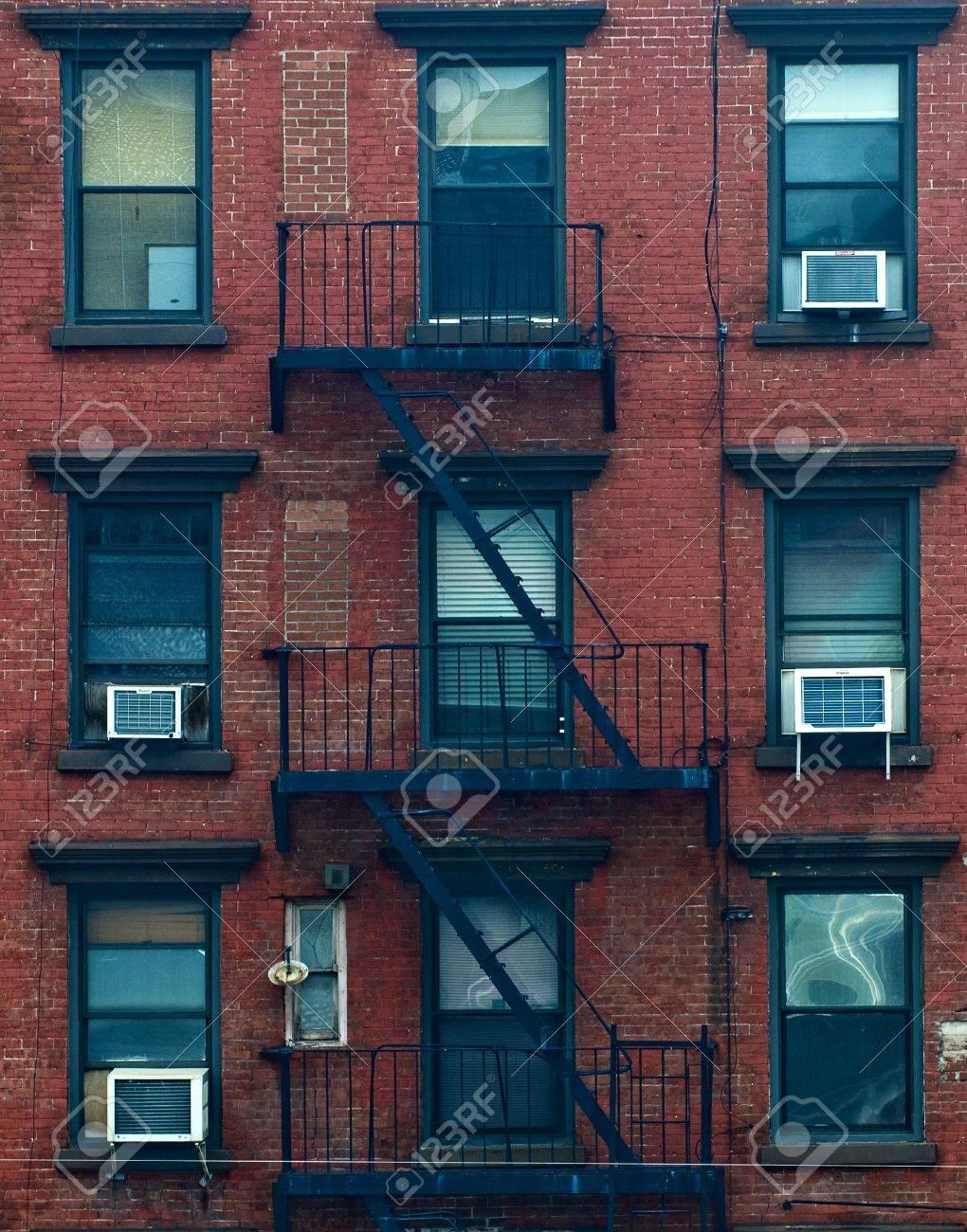 Apartment Building Fire Escape Ladder a fire escape of an apartment building in new york city stock