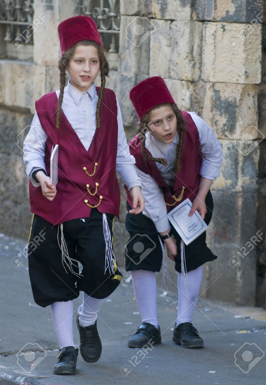 JERUSALEM - MARS 09 : Ultra Orthodox costumed boys during Purim in Mea Shearim Jerusalem on Mars 09 2012 , Purim is a Jewish holiday celebrates the salvation of the jews from jenocide in ancient Persia  Stock Photo - 12618647