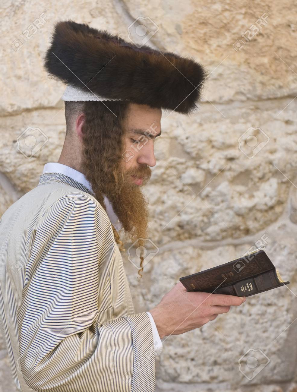 JERUSALEM - APRIL 08 : Orthodox jewish men prays in The western wall during Passover on April 08 2012 , The Western wall is important Jewish religious site located in the Old City of Jerusalem  Stock Photo - 14418255