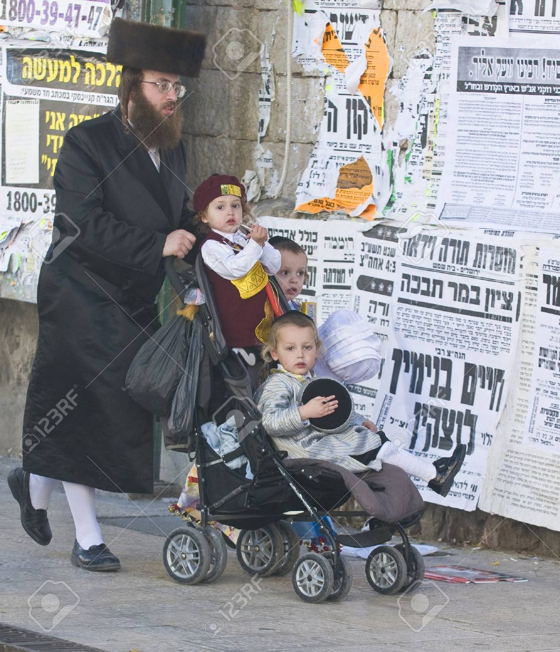 JERUSALEM - MARS 09 : Ultra Orthodox family during Purim in Mea Shearim Jerusalem on Mars 09 2012 , Purim is a Jewish holiday celebrates the salvation of the jews from jenocide in ancient Persia  Stock Photo - 14816857