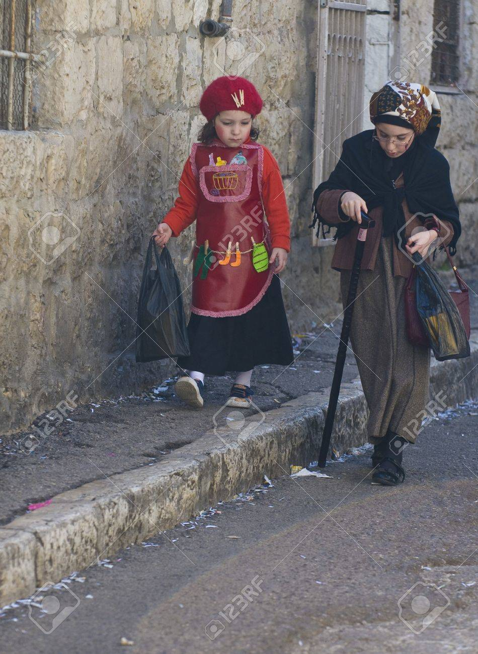 JERUSALEM - MARS 09 : Ultra Orthodox costumed children during Purim in Mea Shearim Jerusalem on Mars 09 2012 , Purim is a Jewish holiday celebrates the salvation of the jews from jenocide in ancient Persia  Stock Photo - 15079216