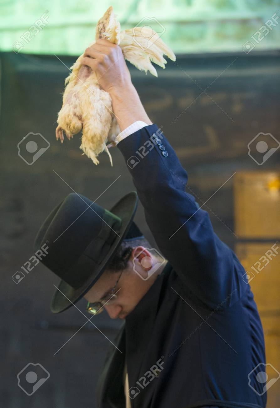 JERUSALEM - SEP 25 : An ultra Orthodox Jewish man waves a chicken over his head during the Kaparot ceremony held in Jerusalem Israel in September 25 2012  Stock Photo - 15452917