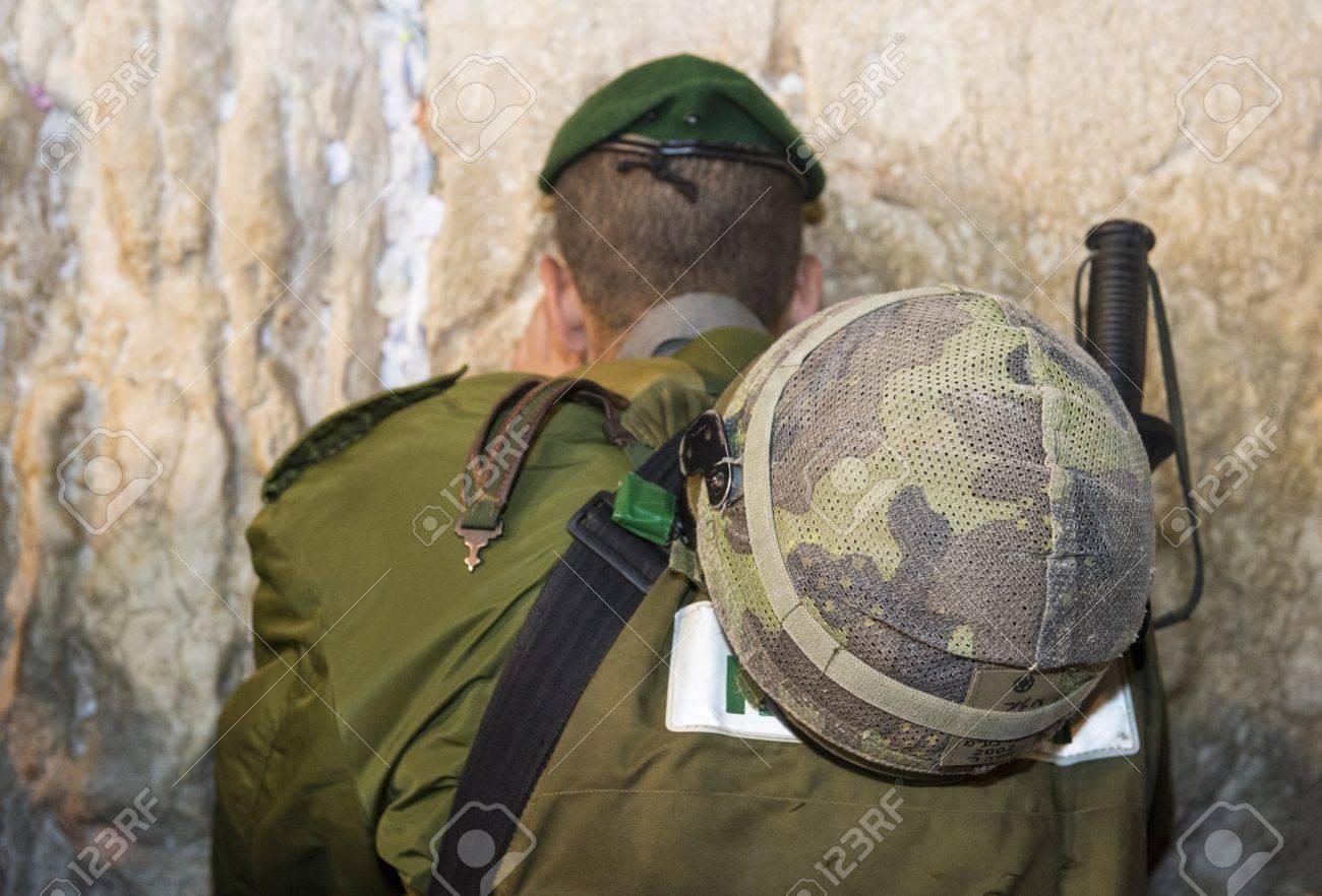 JERUSALEM - SEP 25 :Israeli soldier prays during the penitential prayers the Selichot , held on September 25 2012 in the Wailing wall in Jerusalem Israel - 17003045