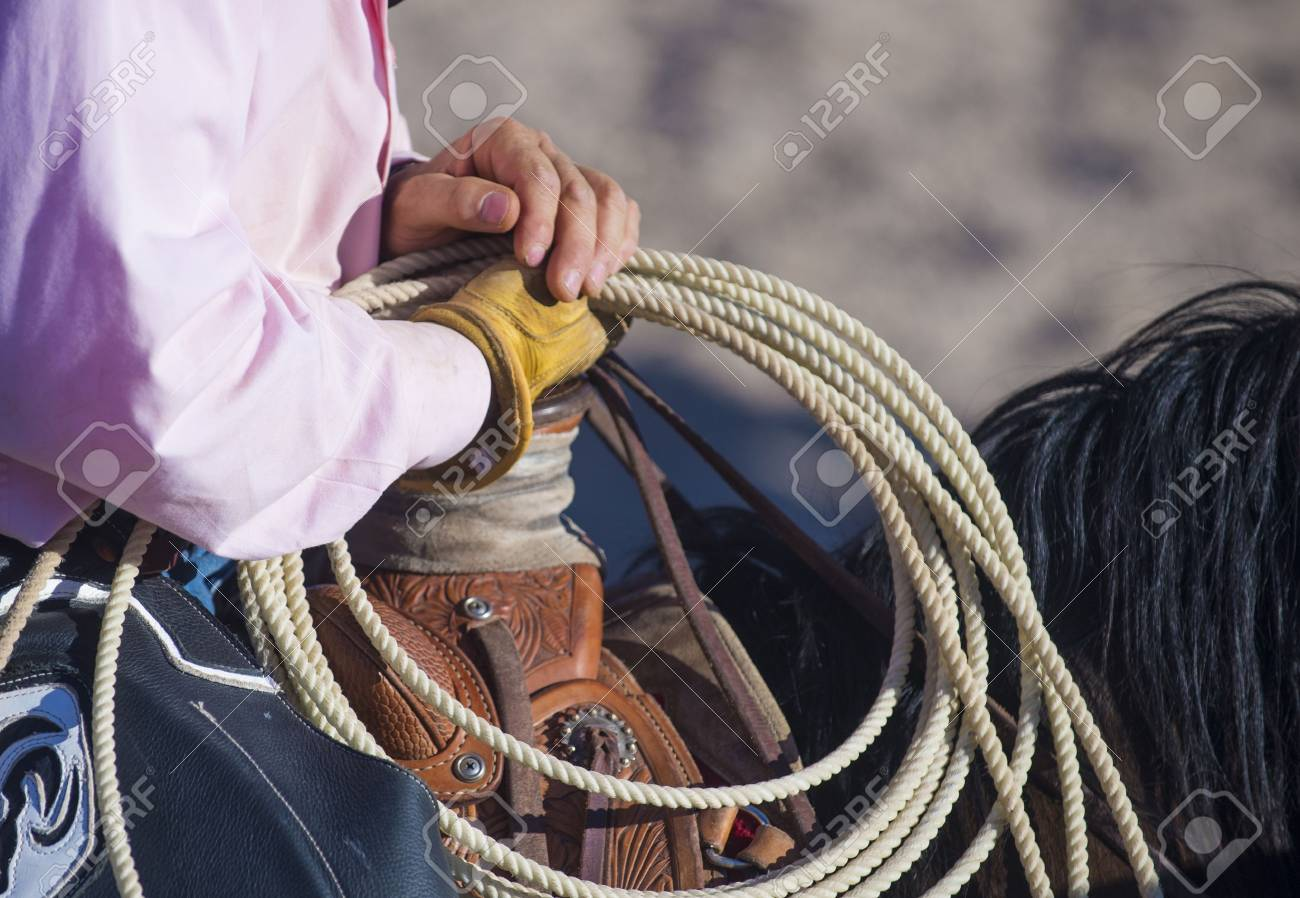 A cowboy waiting to compete in a rodeo - 20323225