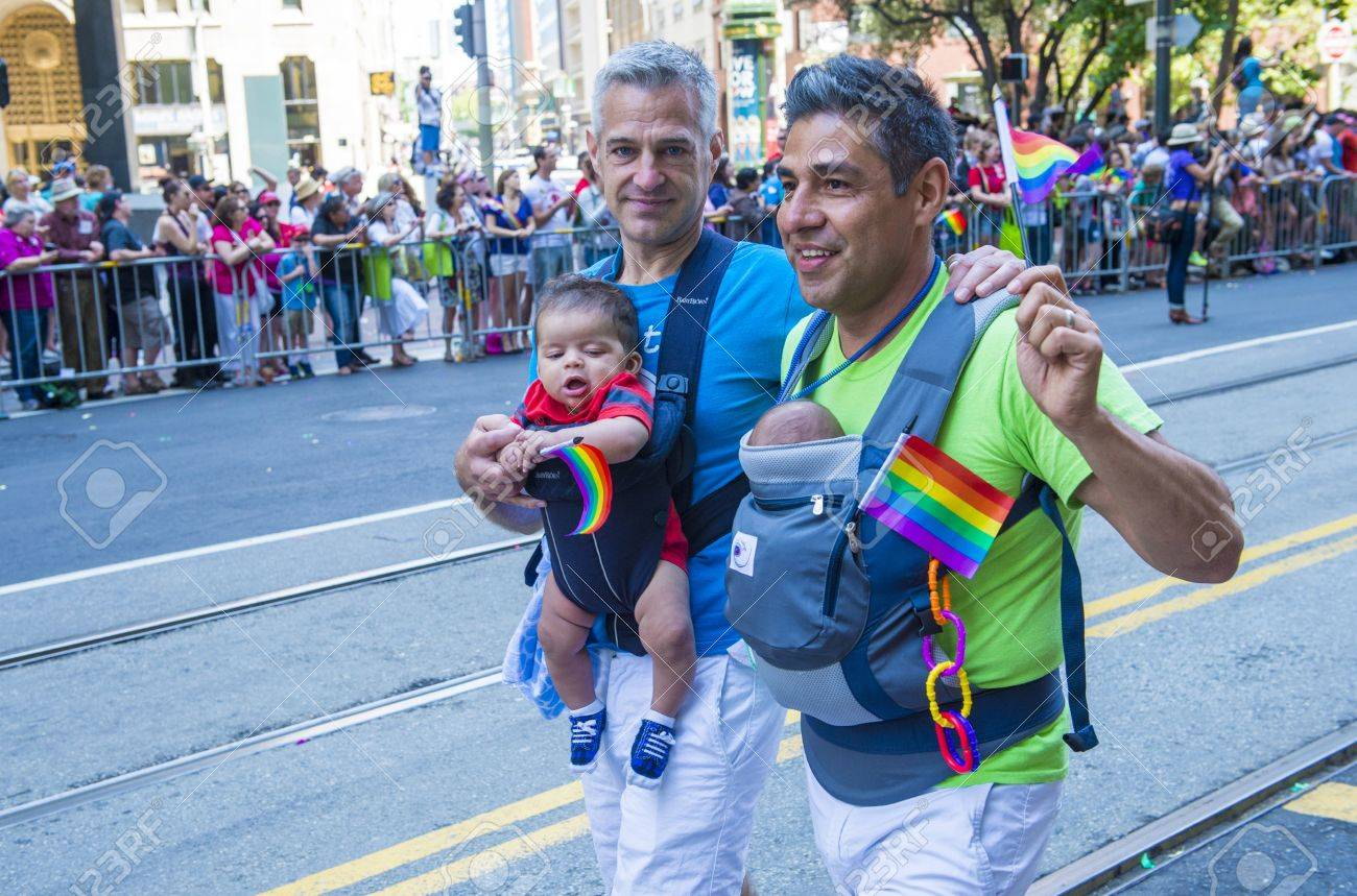 SAN FRANCISCO - JUNE 30 : An unidentified Gay couple participates at the annual San Francisco Gay pride parade on June 30 2013 - 20938355