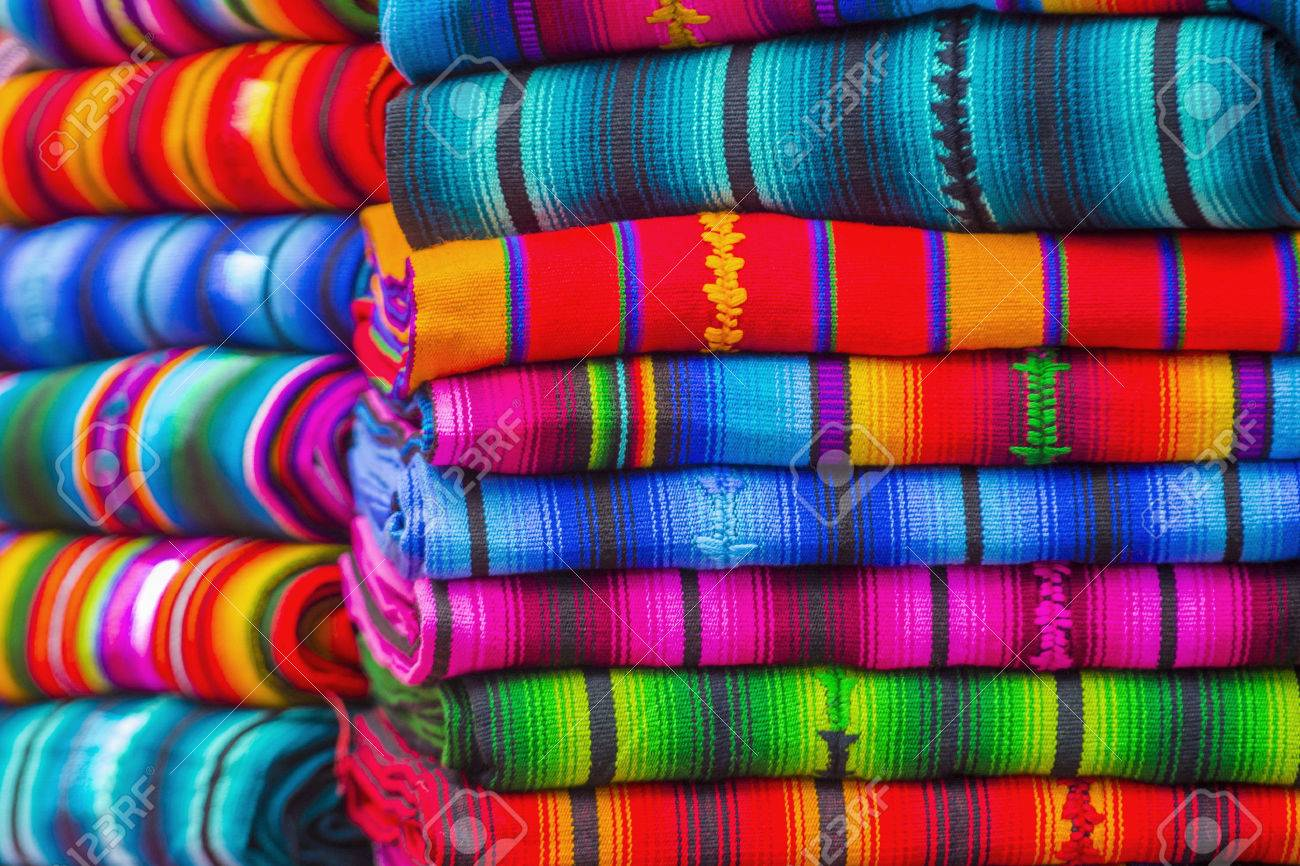 Mayan blankets textile designs on the market in Chichicastenango in Guatemala - 44269776