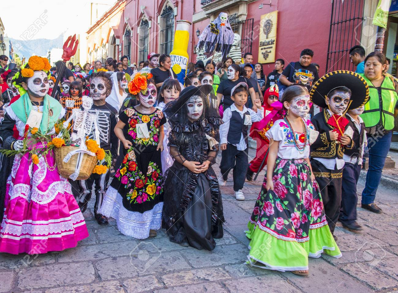 OAXACA , MEXICO - NOV 02 : Unknown participants on a carnival of the Day of the Dead in Oaxaca, Mexico, on November 02 2015. The Day of the Dead is one of the most popular holidays in Mexico - 47981339