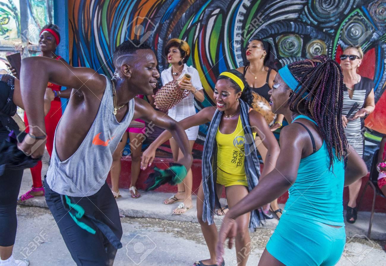 HAVANA, CUBA - JULY 18 : Rumba dancers in Havana Cuba on July 18 2016. Rumba is a secular genre of Cuban music involving dance, percussion, and song. It originated in the northern regions of Cuba - 61025887