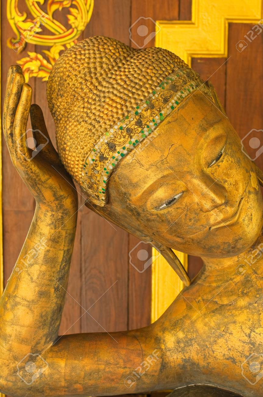 Face of reclining buddha made from wood, Thailand. Stock Photo - 10455260