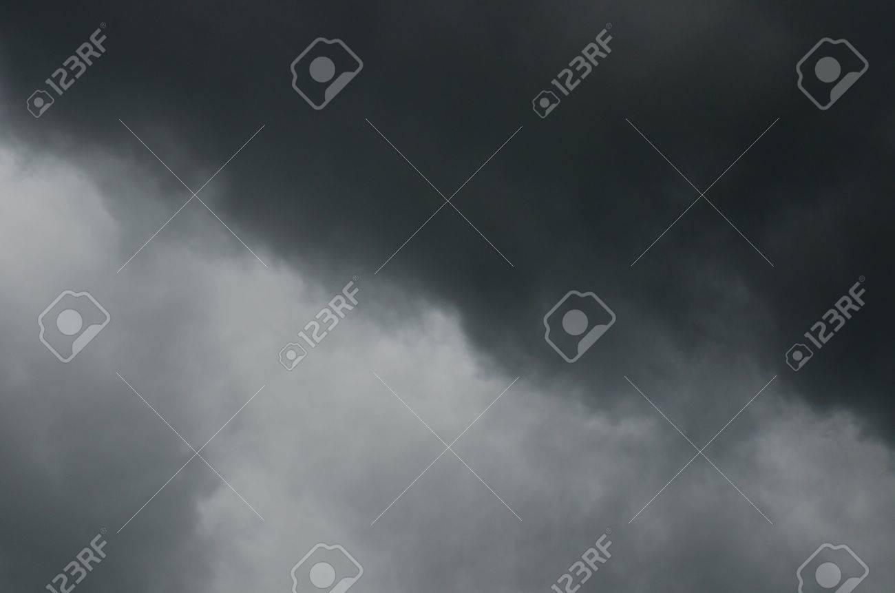 Black rainy cloud on white sky, Thailand. Stock Photo - 16560795
