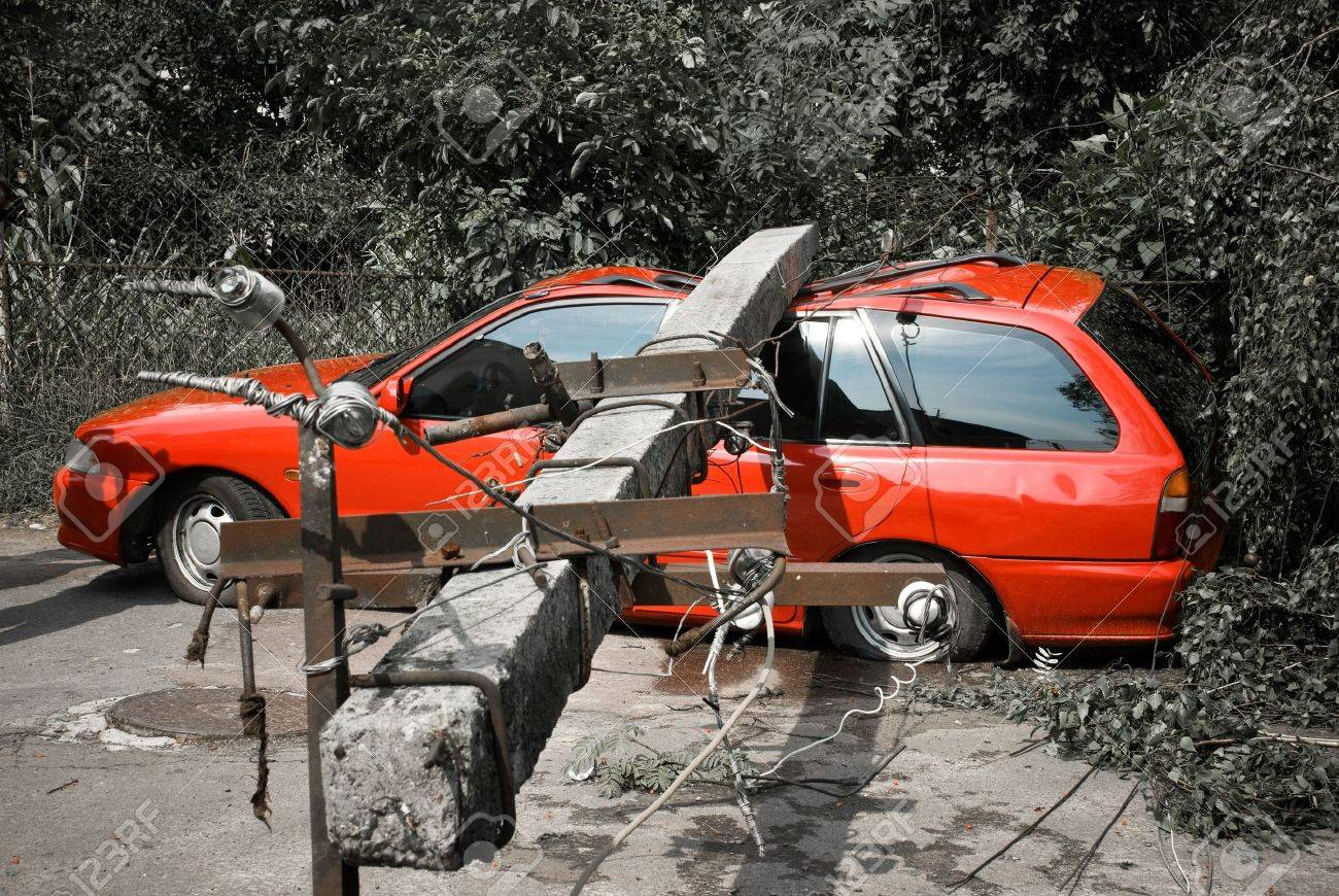 electric post fallen onto red car Stock Photo - 5299509