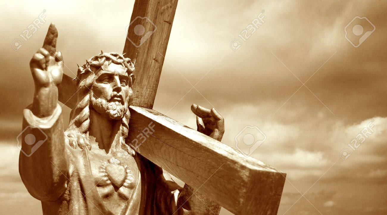 jesus holding cross on cloudy sky background stock photo picture
