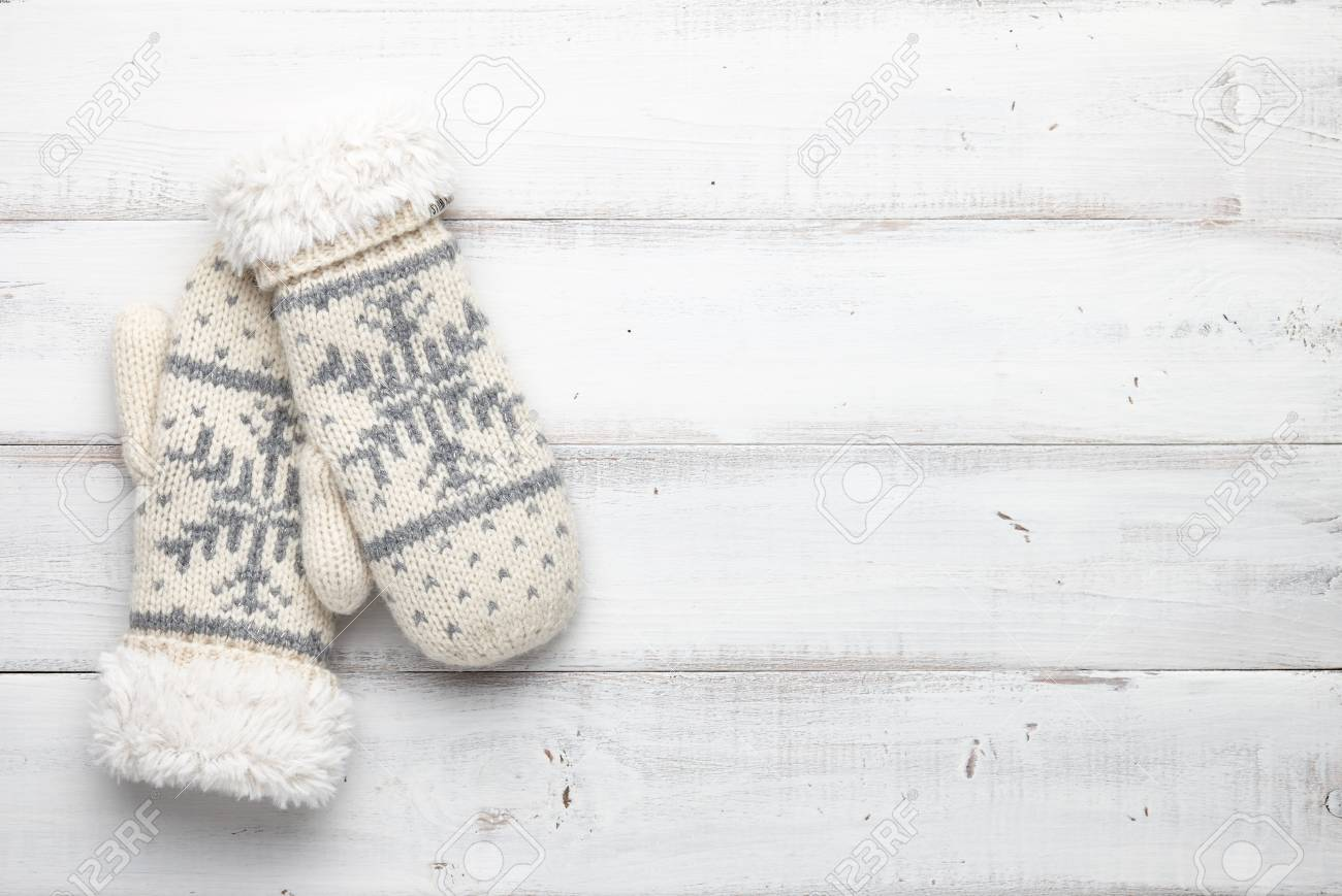 White Knitted Mittens With Winter Snowflakes Pattern On White ...