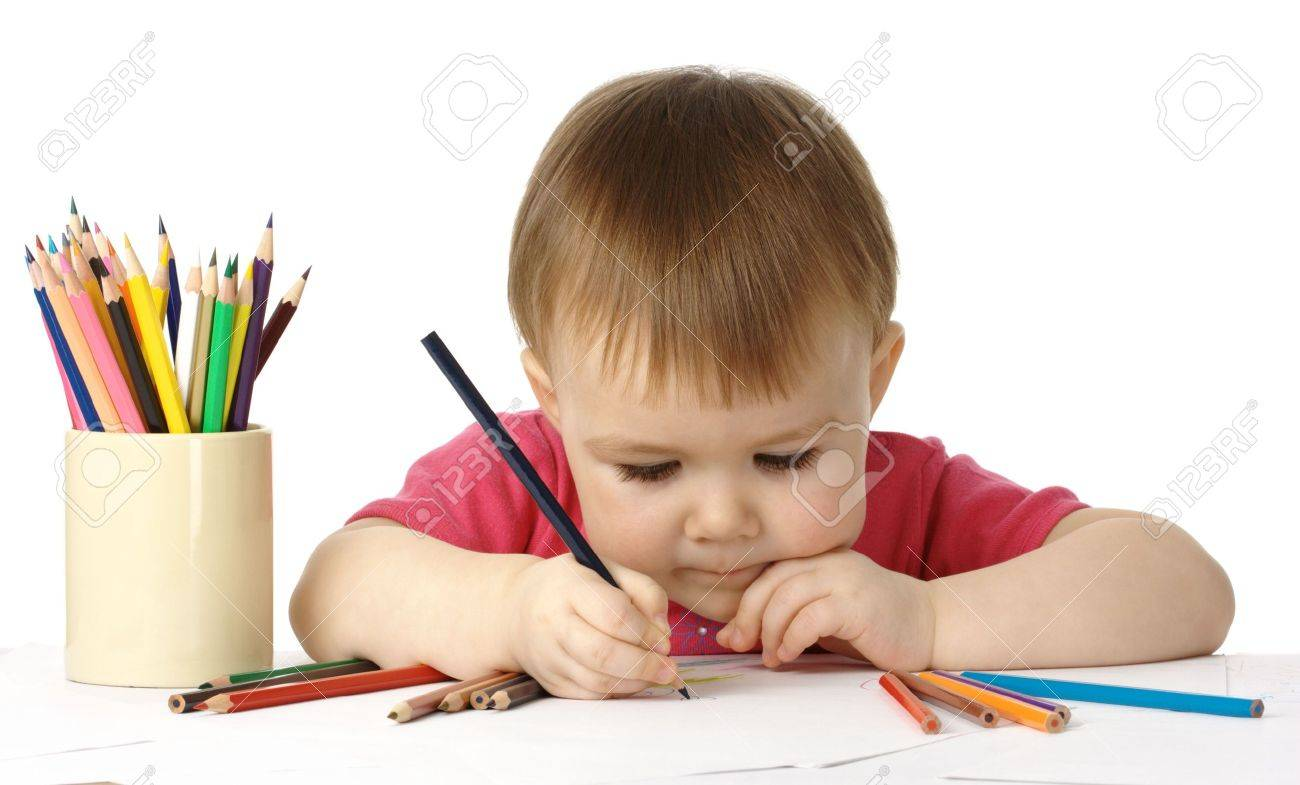 Cute child, focused, drawing on white paper, isolated Stock Photo - 4618627